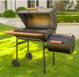 black charcoal grill in a backyard lawn
