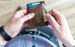 man getting money in a wallet